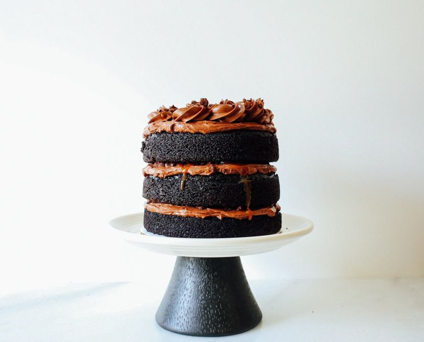 Chocolate Caramel Crumble Cake This is a rich, fluffy, and moist dark chocolate cake make with dutch process / special dark cocoa powder. The cake recipe is a one bowl, simple, easy, make ahead cake recipe. The cake is filled with chocolate cookie crumbles made like milk bar crumb. There is also a sweet and salty caramel in the middle and a fluffy chocolate frosting made from melted semisweet and bittersweet chocolate chips. You can make this a naked cake or frost the outside as well. Find the recipe for this celebration / birthday cake / chocolate lover best cake on thewoodandspoon.com