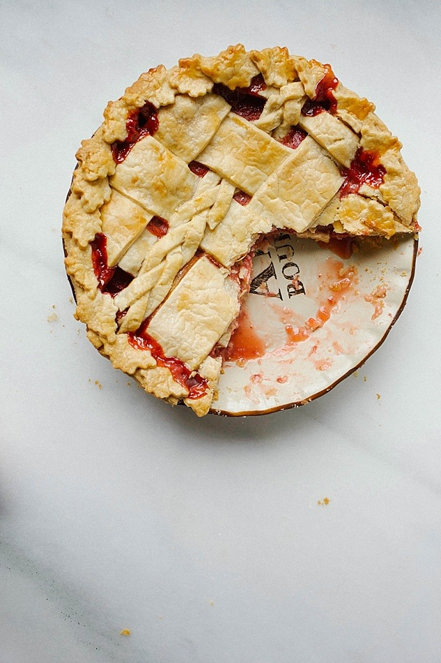Strawberry Rhubarb Pie Recipe by The Wood and Spoon Blog. Tart rhubarb, sweet berries and a touch of cinnamon make this the perfect pie. Post includes information on how to use and trim rhubarb, tips on preparing the perfect flaky butter pie crust, and other spring pie inspiration. Can be made with a decorative or lattice pie top. thewoodandspoon.com