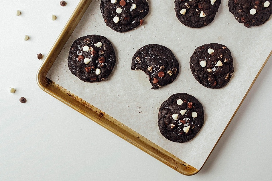 Triple Chocolate Cookies Recipe by The Wood and Spoon Blog by Kate Wood. A rich, soft, and chewy dark chocolate chip cookies with crispy crunchy edges and gooey white and milk / semisweet chocolate chips. This recipe used dutch processed cocoa powder and tastes even better with salty flakes of sea salt on top. This is a simple, one bowl cookie that the whole family will love and will feed a crowd.