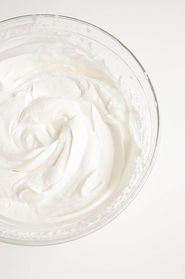 How To Make Whipped Cream Tutorial by The Wood and Spoon Blog by Kate Wood. This is a step by step picture explanation of how to whip cream. Starting with heavy whipping cream and using a wire whisk, hand blender, or stand mixer, this tutorial will give you the recipe for soft, medium, and stiff peaks - even to the point of making your own butter! Learn how to make whipped topping on thewoodandspoon.com