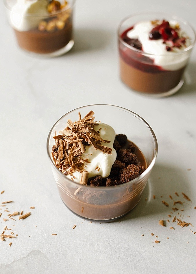 Chocolate Budino Recipe by The Wood and Spoon Blog by Kate Wood. This is a rich chocolate Italian pudding with three different flavor and topping variations. Chocolate crumble, hazelnut, and fresh berries! Make the creamy dessert ahead of time and store in the fridge until you're ready to top with whipped cream and nutty crumbly toppings. Find the recipe and how to for this custard based dessert on thewoodandspoon.com