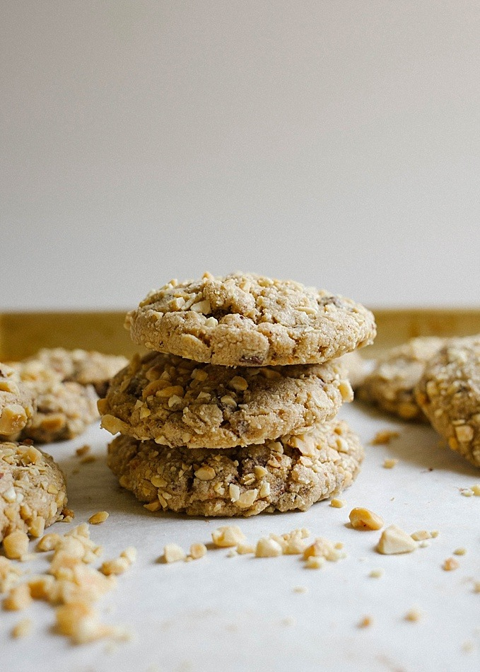 Peanut Butter Chocolate Chunk Cookies by Wood and Spoon Blog by Kate Wood. This is a thick and chewy cookie flavored with peanut butter, roasted peanuts, and semisweet or dark chocolate chunks. Oatmeal gives these cookies an extra chewy inside. These cookies freeze well and can be made ahead and are healthier because of added protein from nut butter and fiber from oats. Find the recipe on thewoodandspoon.com