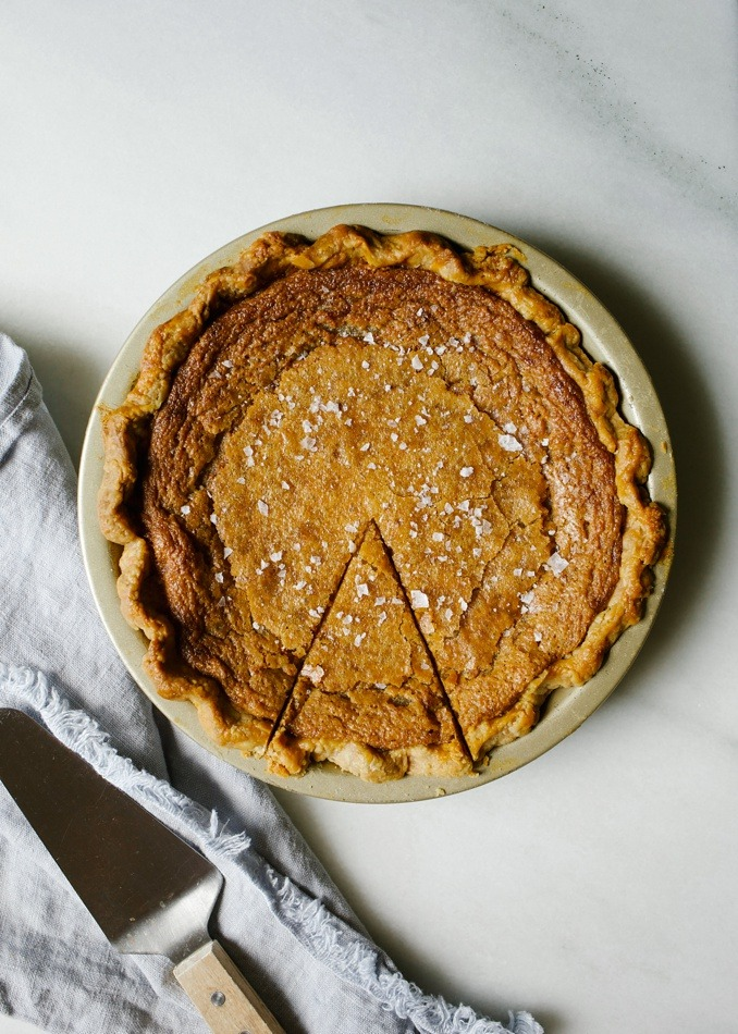 Salted Maple Pie by Wood and Spoon. This is a decadent chess pie recipe from Sister Pie in Detroit! Made with eggs, maple syrup, and a buttery flaky crust, this pie is a sweet and salty lover's dream! Perfect for the fall and holidays, this pie would be at home on any Thanksgiving table. Find the recipe and how to for par-baking crust and knowing when this pie is done on thewoodandspoon.com by Kate wood.