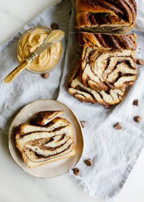 Peanut Butter Chocolate Babka by Wood and Spoon. This is a fluffy and sweetened braided bread filled with dark chocolate and peanut butter. This can serve as dessert or morning pastry! Making babka can be hard to learn how to do but with these steps you'll be baking in no time! Read more at thewoodandspoon.com by Kate Wood