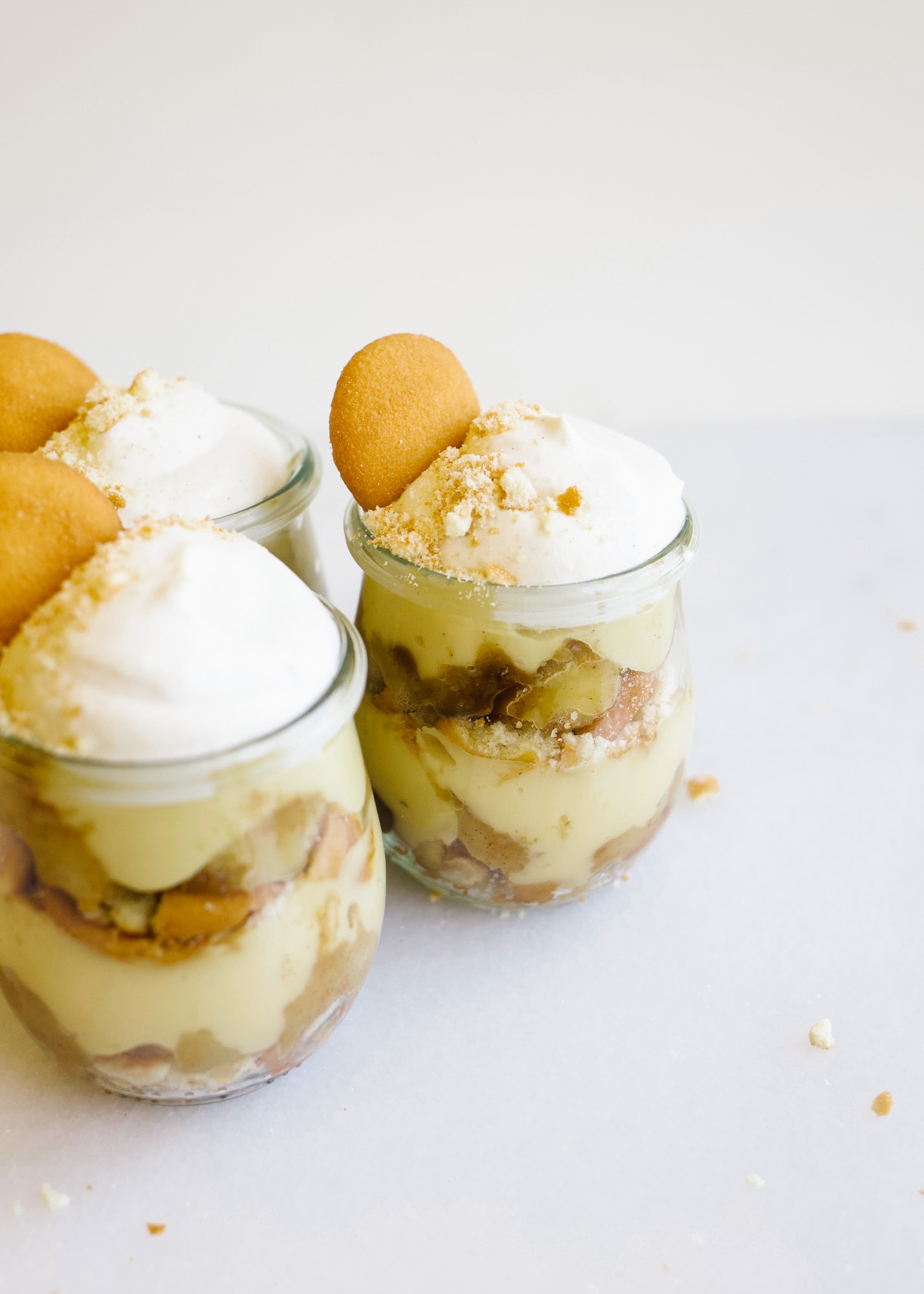 Caramelized Banana Pudding by Wood and Spoon blog. This is a traditional Southern style banana pudding dessert made with vanilla wafers, whipped cream, and caramelized bananas. The cinnamon-scented syrup of the bananas adds great flavors and makes for a fun alternative to banana pudding. Serve these in whole containers or miniature individual jars. Learn more about this summer dessert on thewoodandspoon.com