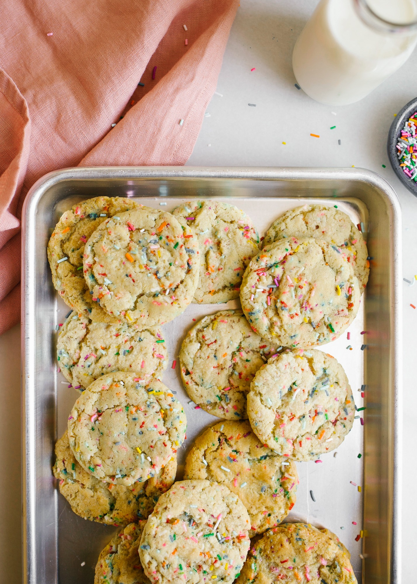 Vegan Funfetti Cookies by Wood and Spoon by Kate Wood. These are healthier sprinkle cookies made with coconut oil and organic sugar and flour. Clear vanilla extract gives the cookies their flavor. The cookies have crinkle tops and are loaded with colorful rainbow sprinkles. Learn how to make these at home on thewoodandspoon.com