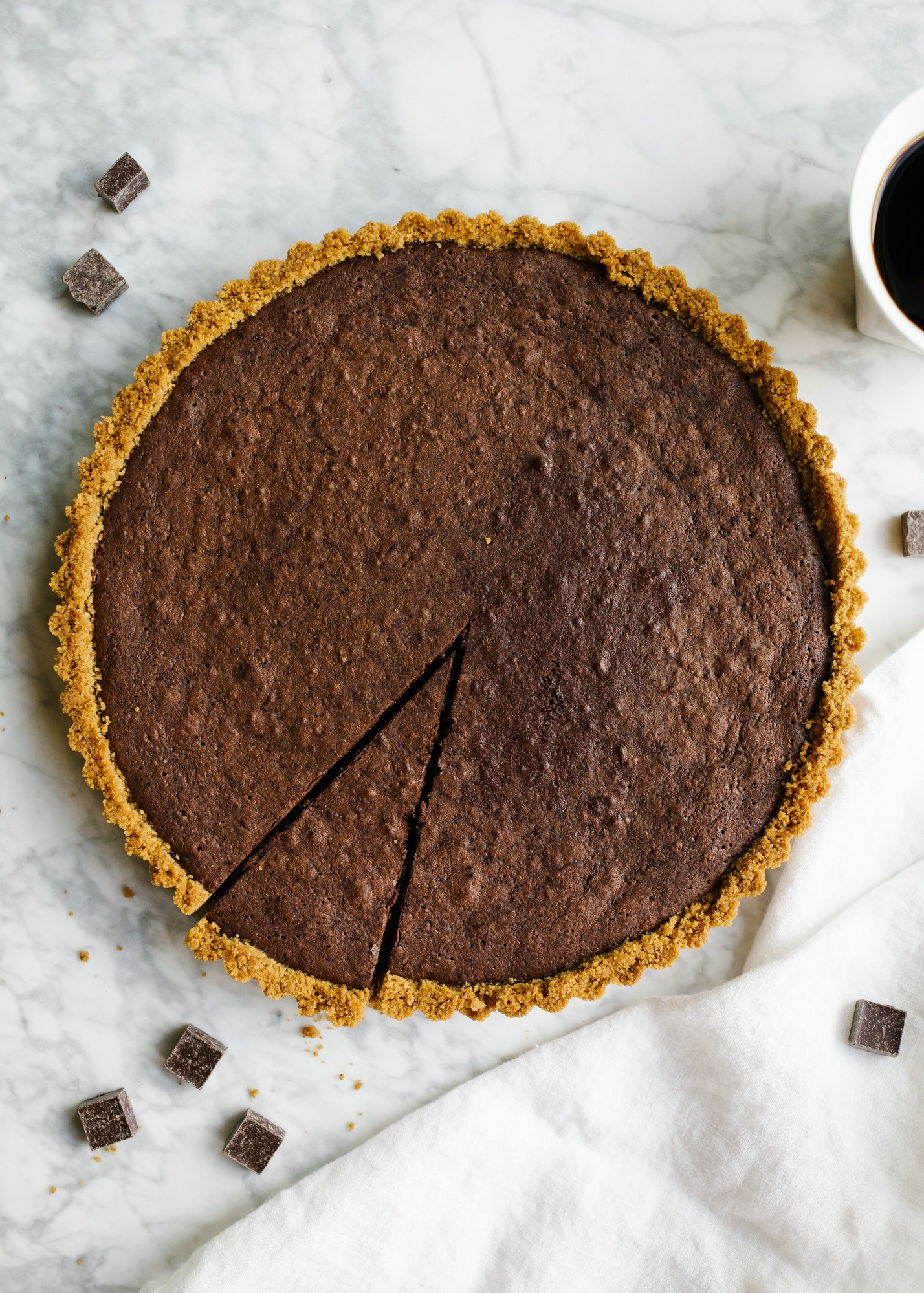 Fudgy Brownie Tart by Wood and Spoon by Kate Wood. This is a graham cracker press in butter crust with a melted chocolate and cocoa powder brownie milk tart. It's rich with the addition of Red Diamond Coffee and tastes best with a. sprinkle of flaky sea salt. Learn more about this simple holiday dessert recipe for a crowd on thewoodandspoon.com.