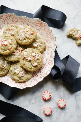 White Chocolate Peppermint Cookies by Wood and Spoon blog. These are vegan cookies with chunks of candy cane and bits of chopped white chocolate chips throughout. The cookie is made with a flaxseed egg and stays chewy throughout. Perfect for holiday and Christmas baking plates and parties and fun to make with kids! Learn more about the recipe on thewoodandspoon.com