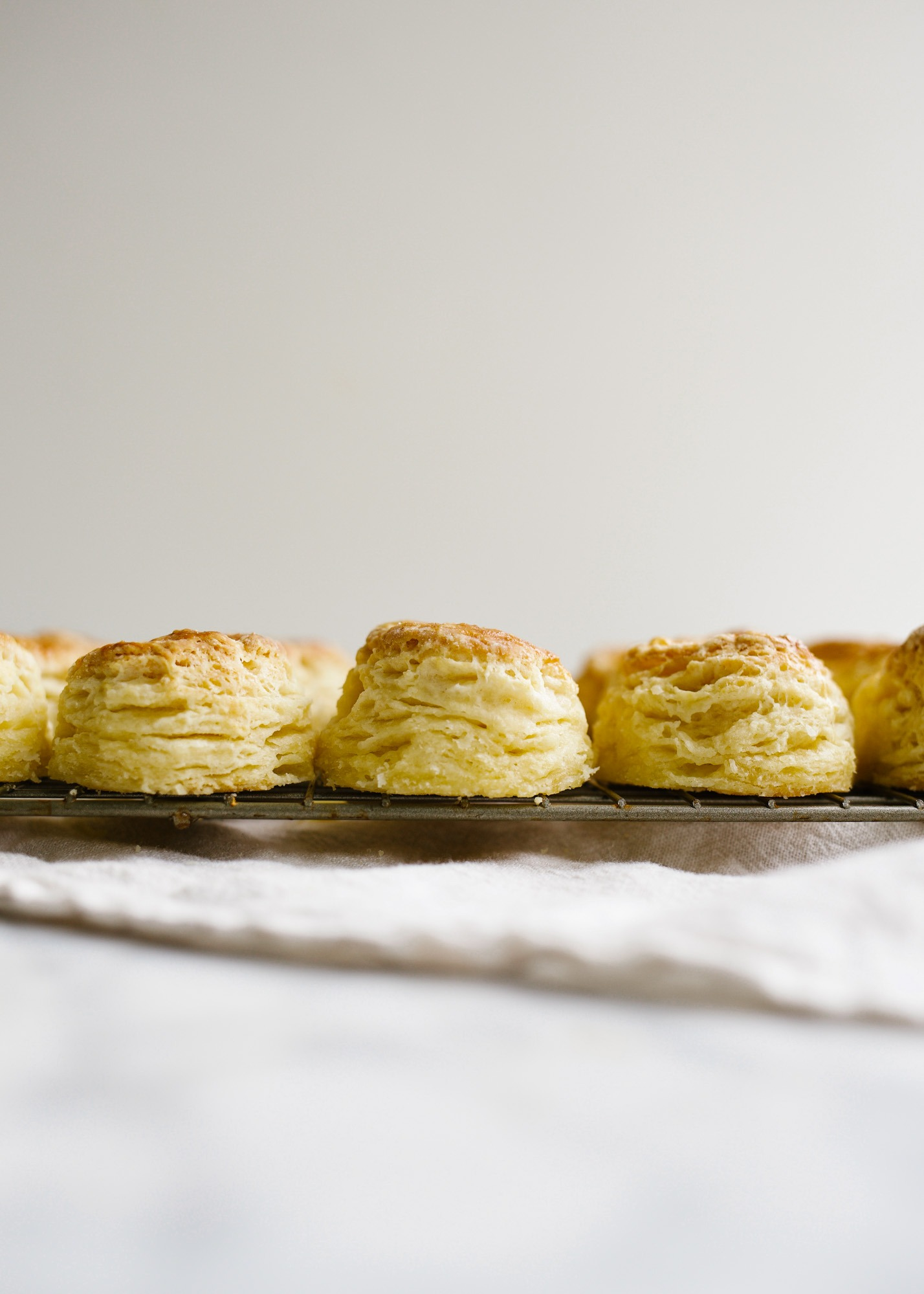 Mini Buttermilk Biscuits by Wood and Spoon blog. These are buttery bite sized laminated biscuits with flaky layers and loads of flavor. Learn how to make perfect Southern biscuits at home that taste even better than the store bought ones in the can. Also some things to do while social distancing and staying at home with coronavirus. Learn what moms and women can do at home now on thewoodandspoon.com