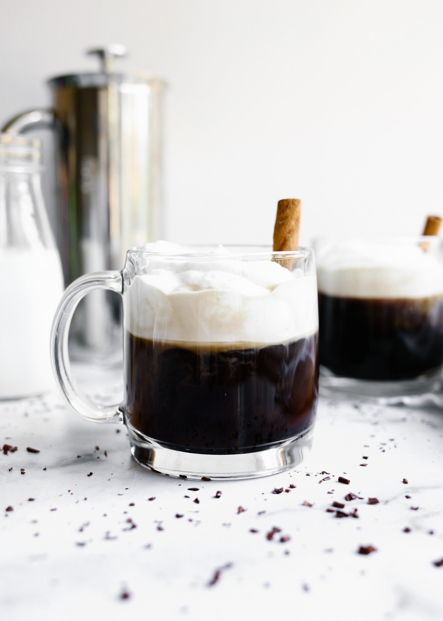 Kentucky Coffee by Wood and Spoon blog. This is a sweetened bourbon coffee topped with whipped cream and served warm as an after dinner beverage. Homemade whipped cream sweetens the coffee and added liquor provides an extra kick to the morning drink. Recipe found on thewoodandspoon.com