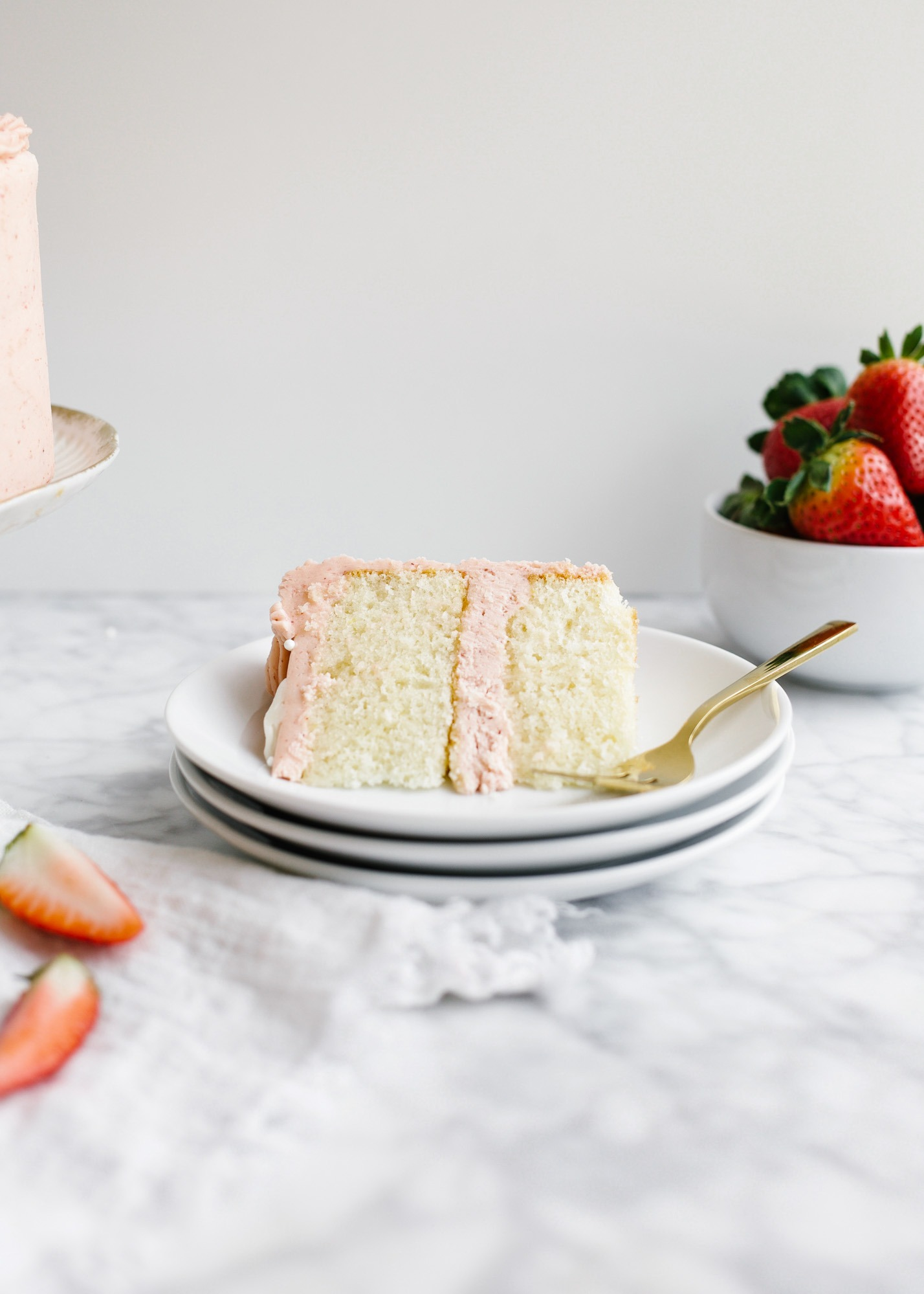 """Champagne and Strawberries Cake by Wood and Spoon blog. This is a simple champagne scented layered cake topped with a real strawberry American buttercream and made extra moist with a champagne simple syrup. Two layers make up this small 6"""" cake which is perfect to gift or share with a valentine. Learn how to make this romantic date night in cake on thewoodandspoon.com"""