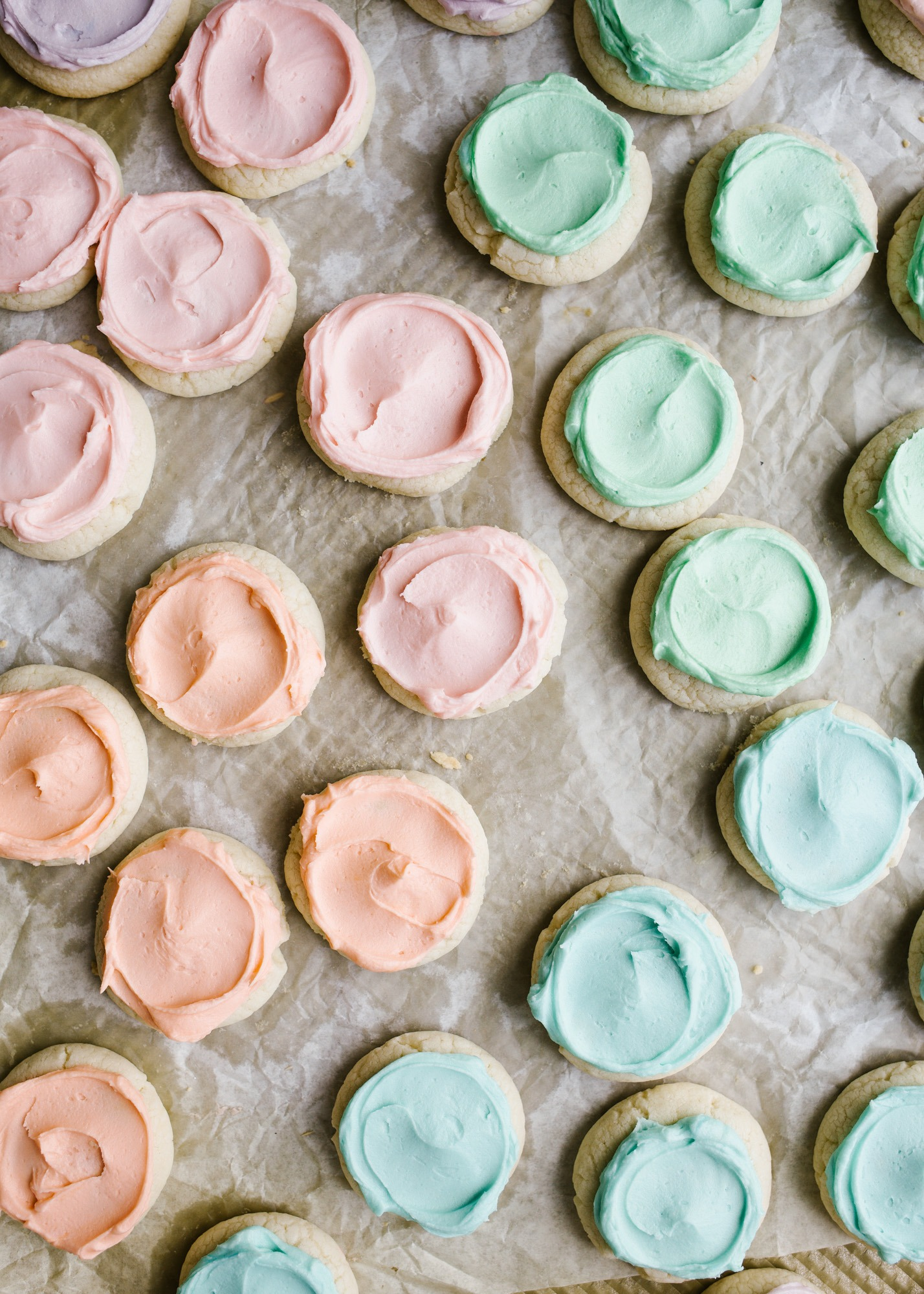 Pastel Lofthouse Cookies by Wood and Spoon Blog. These are copycat cookies for mini Lofthouse cookies that you can make homemade in your own favorite buttercream colors! Learn how simple these drop sugar cookies are and how to make that soft and fluffy buttercream cookie frosting on thewoodandspoon.com