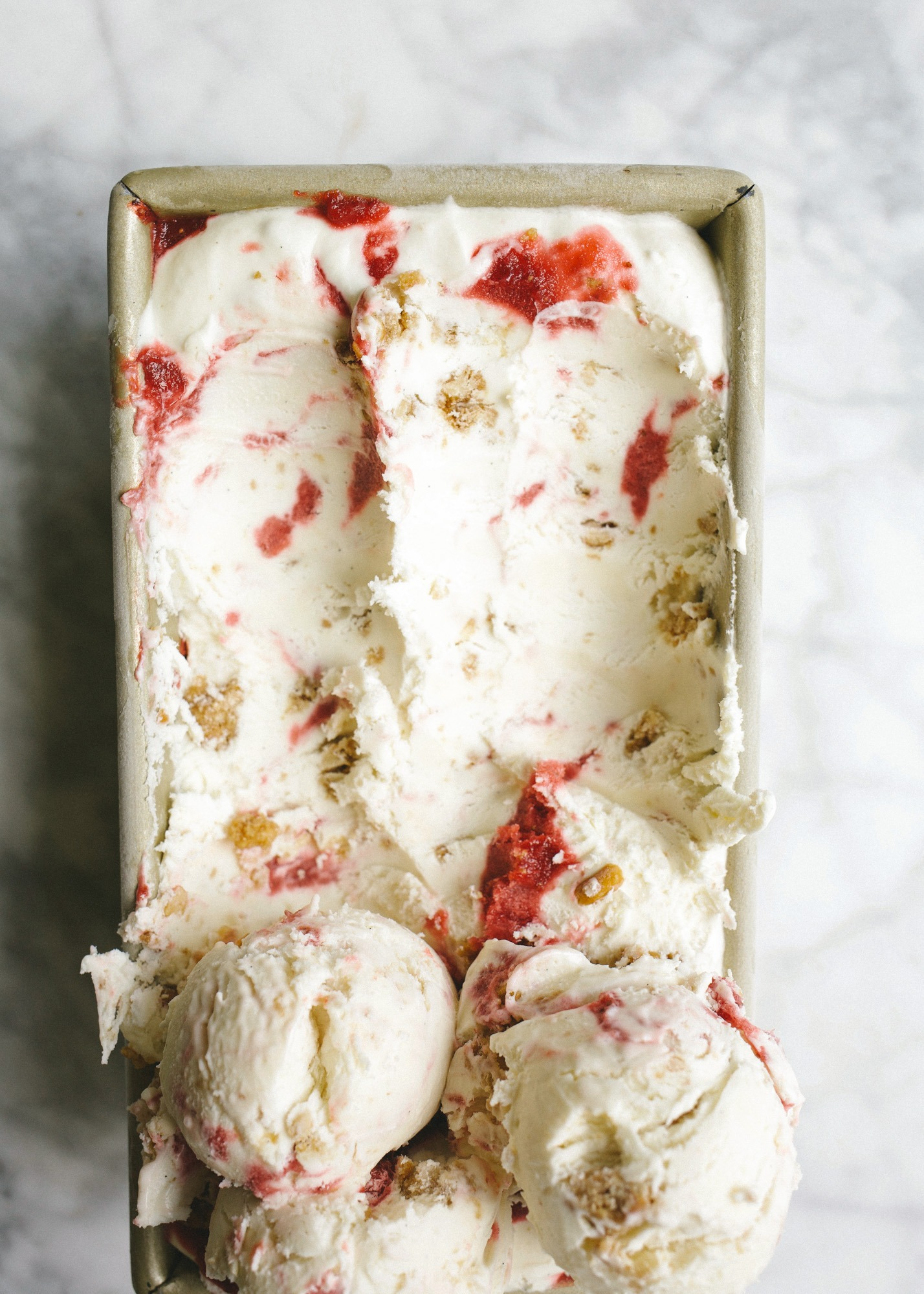 No-Churn Strawberry Pretzel Pie Ice Cream and A Father's Day Gift Guide! Learn how simple it is to make a no-churn ice cream that tastes like the classic strawberry pretzel pie casserole dessert! A cream cheese ice cream is swirled with a stovetop strawberry sauce and crumbled bits of pretzel crunch. The end result is a deliciously balanced and textured dessert that even non-ice cream lovers will love! Also, shop for all the dads in your life with this no-frills gift guide!